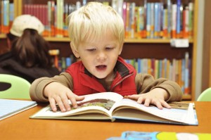 Kid reading from IStockphoto