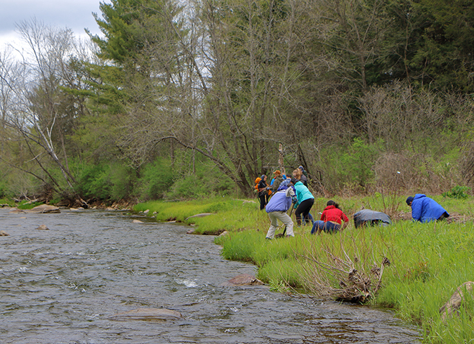 Volunteer group working along river